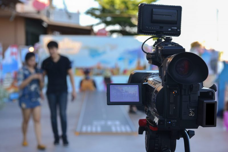 A video camera that uses live video streaming with actors walking in front